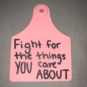 """Pink """"fight for things you care"""" cow tag keychain"""
